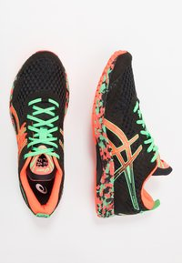 ASICS - GEL-NOOSA TRI 12 - Competition running shoes - black/flash coral - 1