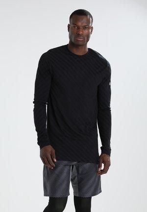 SEAMLESS - Sports shirt - performance black