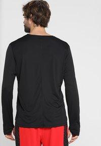 ASICS - Long sleeved top - performance black - 2
