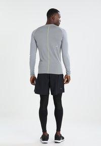 ASICS - BASELAYER LONG  - Leggings - performance black - 2