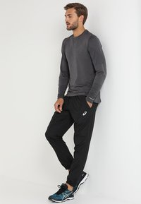 ASICS - SILVER WOVEN  - Trousers - performance black - 1