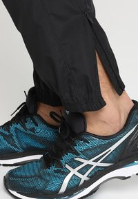 ASICS - SILVER WOVEN  - Trousers - performance black - 3
