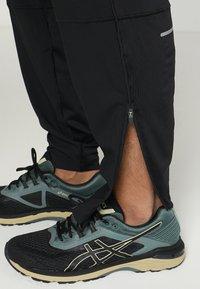 ASICS - PANT - Teplákové kalhoty - performance black - 3