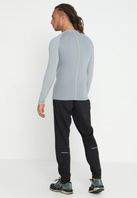 ASICS - PANT - Teplákové kalhoty - performance black - 2