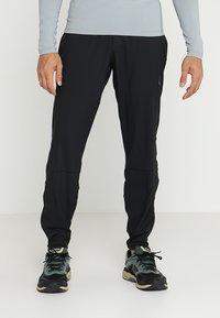 ASICS - PANT - Teplákové kalhoty - performance black - 0