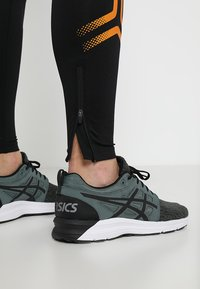 ASICS - ICON - Collants - performance black/amber - 3