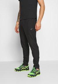 ASICS - RACE PANT - Spodnie treningowe - performance black - 0