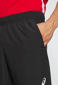 ASICS - CLUB PANT - Tracksuit bottoms - performance black - 4