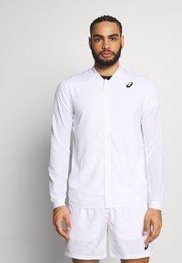 ASICS - CLUB JACKET - Sportovní bunda - brilliant white - 0