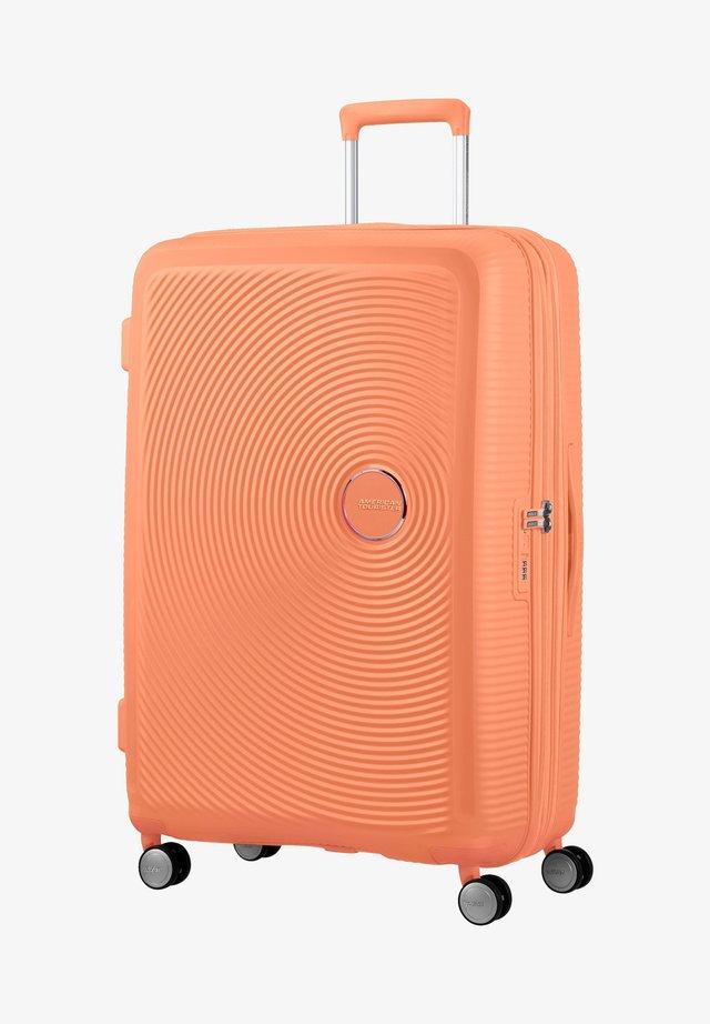 SOUNDBOX - Wheeled suitcase - cantaloupe