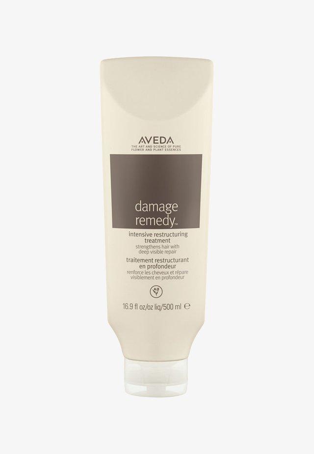 DAMAGE REMEDY™ INTENSIVE RESTRUCTURING TREATMENT  - Pielęgnacja włosów - -