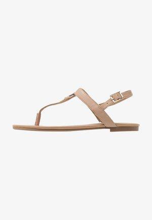 JADENE - T-bar sandals - dark beige