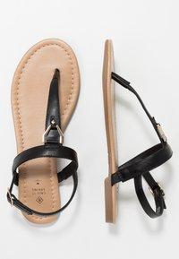 Call it Spring - JADENE - Sandály s odděleným palcem - black - 1