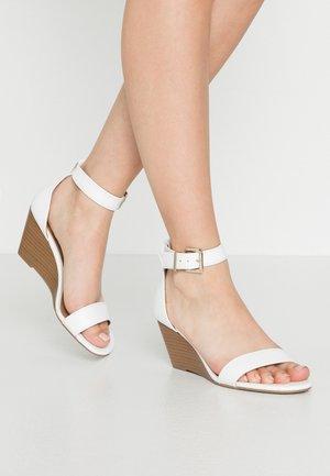 ABAUSSA - Wedge sandals - white