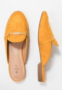 Call it Spring - TRIRESA - Mules - dark yellow - 3