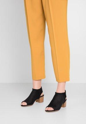 MALINDA - Ankle cuff sandals - black
