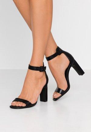 ALEXISS - Sandaler med høye hæler - black