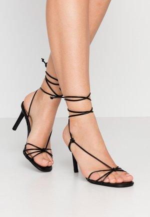 ALVERNA - Korolliset sandaalit - black