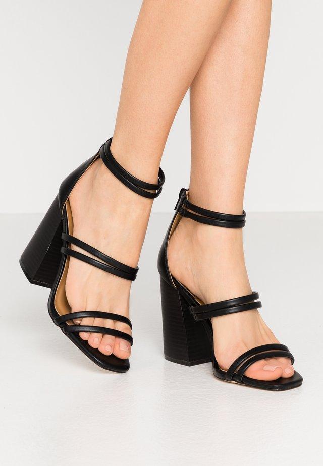 GUVEN - Sandales à talons hauts - black