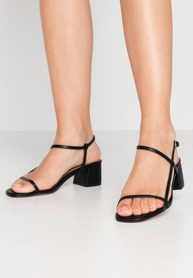 MINII - Sandaalit nilkkaremmillä - black