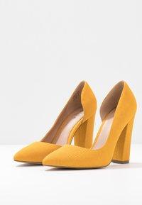 Call it Spring - EMMA - High heels - dark yellow - 4