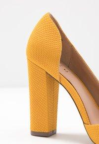 Call it Spring - EMMA - High heels - dark yellow - 2