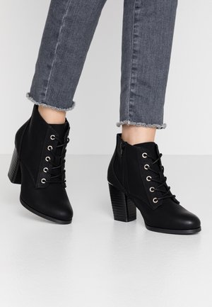 LOUISEE - Ankle boots - black