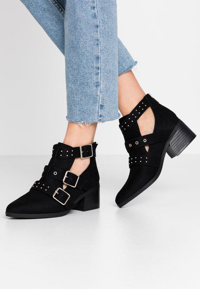 FINN - Ankle boot - black