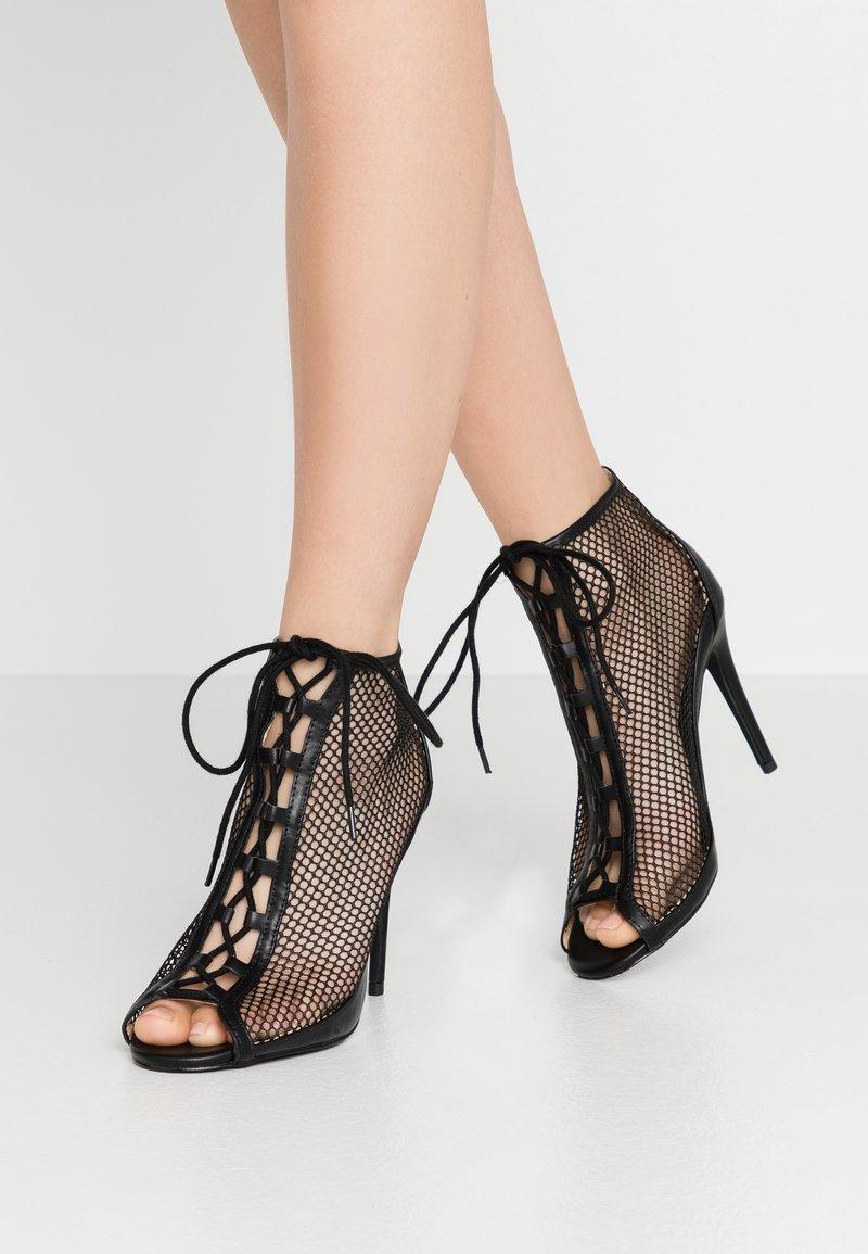 Call it Spring - KHLOEE - Kotníková obuv na vysokém podpatku - black