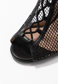 Call it Spring - KHLOEE - Kotníková obuv na vysokém podpatku - black - 2