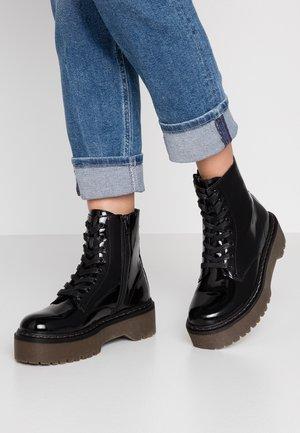 ROCKIT - Kotníkové boty na platformě - black