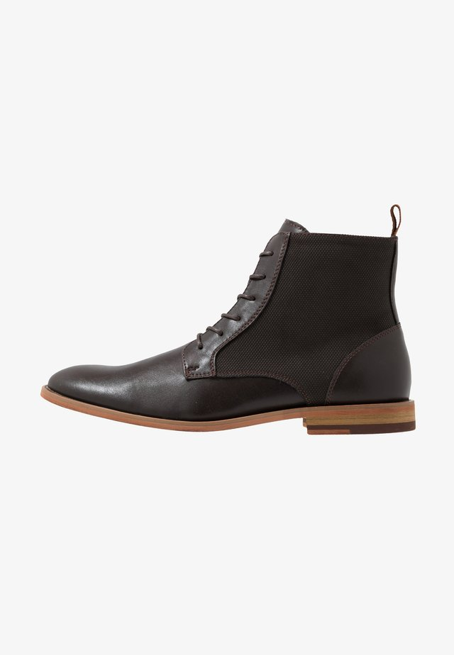 TALSARNAU - Lace-up ankle boots - brown