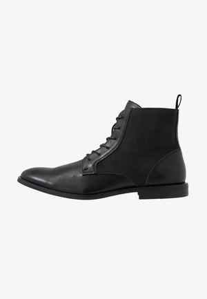 TALSARNAU - Lace-up ankle boots - black