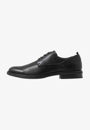 SINDDANIO - Elegantní šněrovací boty - black