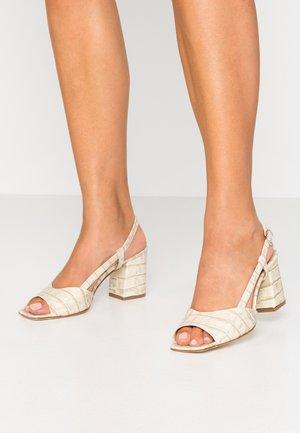 Sandaalit nilkkaremmillä - naturale
