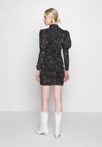 Bardot - CONSTELLATION DRESS - Pouzdrové šaty - black/white - 2