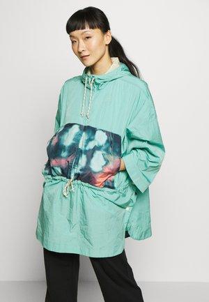 Regenjas - turquoise