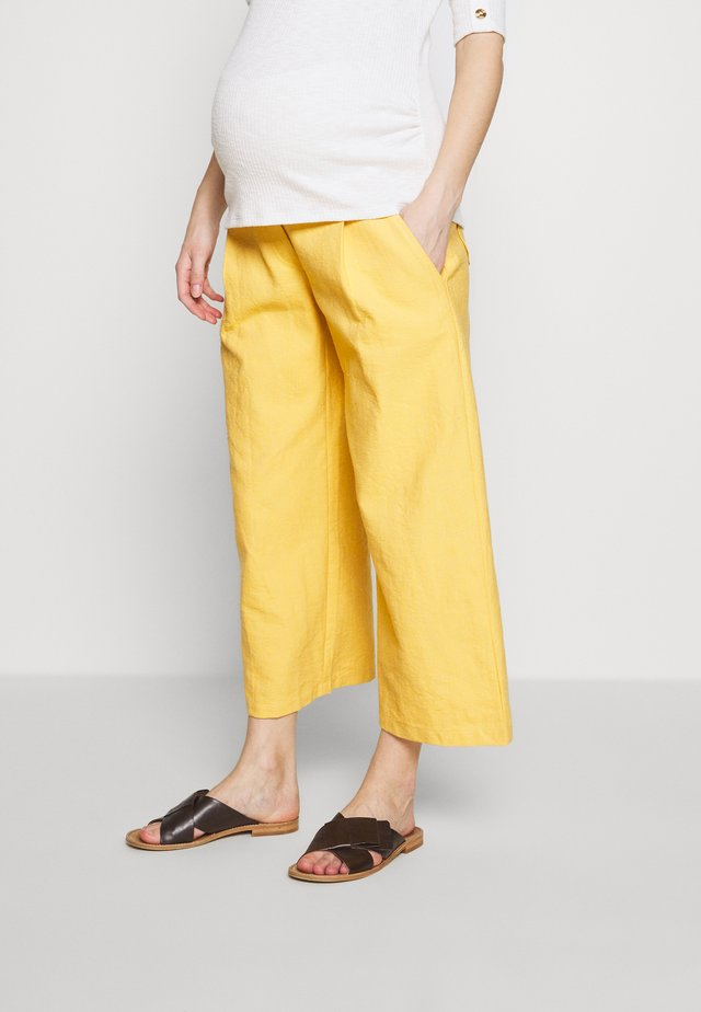 WIDE PANTS WITH FLUID POCKET - Trousers - yellow