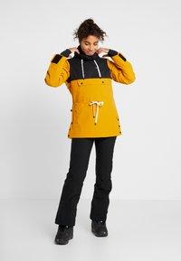 Brunotti - FIREBACK WOMEN SNOWJACKET - Snowboard jacket - autumn yellow - 1