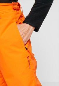 Brunotti - FOOTSTRAP MEN SNOWPANTS - Talvihousut - fluo orange - 5