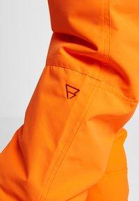 Brunotti - FOOTSTRAP MEN SNOWPANTS - Talvihousut - fluo orange - 7