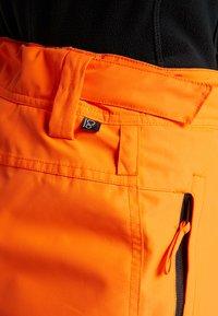Brunotti - FOOTSTRAP MEN SNOWPANTS - Talvihousut - fluo orange - 9