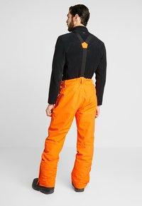 Brunotti - FOOTSTRAP MEN SNOWPANTS - Talvihousut - fluo orange - 2
