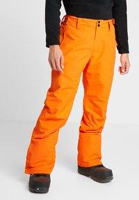 Brunotti - FOOTSTRAP MEN SNOWPANTS - Talvihousut - fluo orange - 4