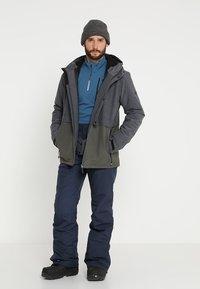 Brunotti - FOOTSTRAP MEN SNOWPANTS - Snow pants - space blue - 1