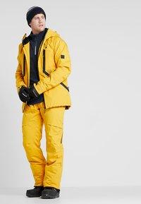 Brunotti - HYENA MENS SNOWPANTS - Snow pants - indian gold - 1