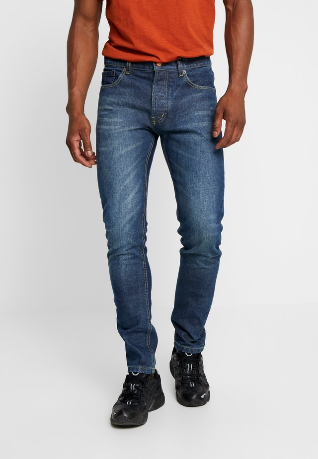 Jeans Tapered Fit - stone wash