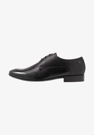 DANSEY - Elegantní šněrovací boty - waxy black
