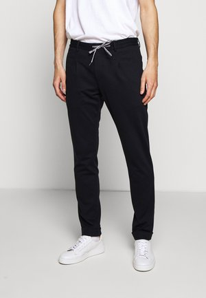 CROSS - Tracksuit bottoms - dark blue
