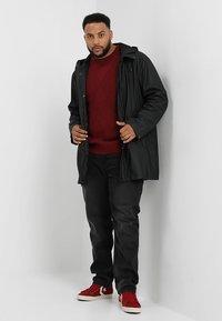 BAD RHINO - PLUS - Slim fit jeans - black - 1
